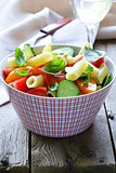 pasta salad with cucumbers, tomatoes and basil