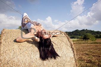 Beautiful woman laying on hay