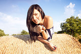 Beautiful woman laying on hay