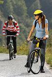women biking on road