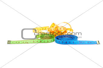 Three measuring tapes of different colors