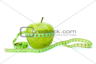 Green apple and measurement tape