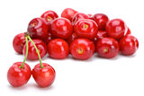 Pile of red ripe cherries and two stand-alone