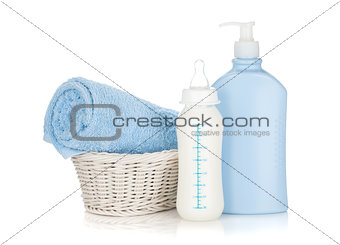 Baby milk bottle, shampoo and towel