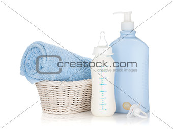 Baby milk bottle, pacifier, shampoo and towel