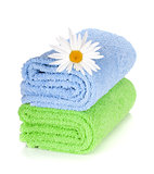 Blue and green towels and camomile flower
