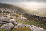 View of misty Malham Dales from limestone pavement above Malham