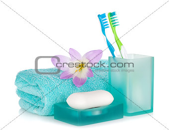Toothbrushes, soap, towel and flower