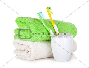 Toothbrushes and two towels