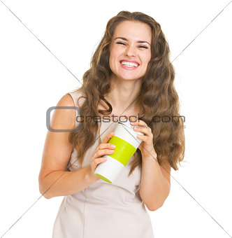 Portrait of smiling young woman with cup of hot beverage