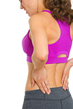 Closeup on woman with back pain