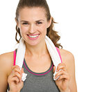 Portrait of smiling fitness young woman with towel