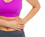Closeup on woman with stomach pain