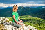Girl meditation at the mountains