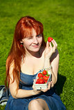 woman with a bowl of strawberries
