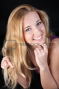 Portrait of the long-haired blonde with a white teeth smile