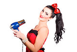 Cute brunette retro woman with hair dryer