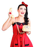 Funny pin-up woman talking on retro phone