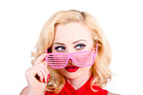Blond pinup girl in stylish retro pink shades