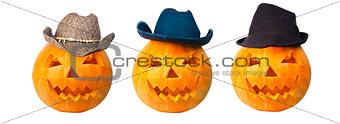 Three cowboy pumpkins