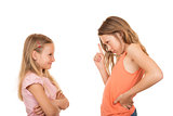 Young girl pointing finger at her sister