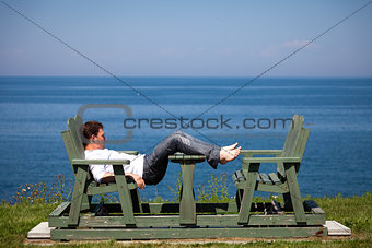 Young man sitting on the bench