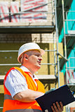 Construction Manager with folder at the scaffolding
