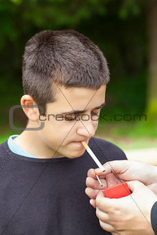 Boy with matches near the cigarette