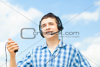 Smiling boy with headphones and Mic