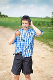 Boy with headphones and Mic on rural road