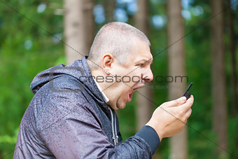 Angry man screaming in phone