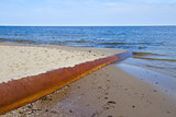 rusted pipe in  blue sea