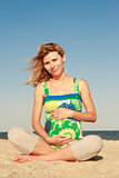 pregnant woman on the beach