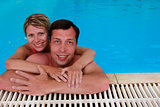 loving couple in the water pool