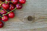 Group of Fresh Ripe Red Sweet Cherries on Wooden Background