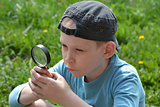 the teenager with a magnifying glass