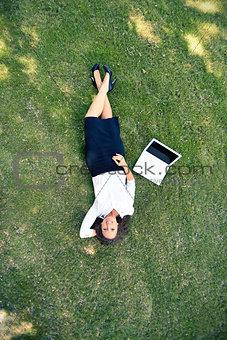 Businesswoman on grass