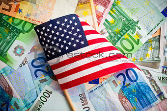 american flag and euro banknotes