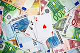 poker cards and euro banknotes