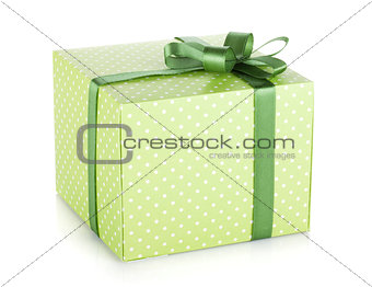 Green gift box with ribbon and bow
