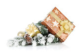Gift boxes and christmas decor on snowy fir tree