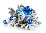Gift box and christmas decor on snowy fir tree