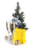 Champagne, fir tree decor and christmas gift
