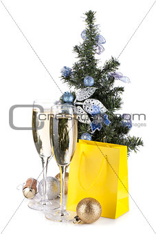 Champagne, fir tree decor and christmas gift