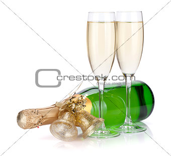 Champagne bottle with christmas decor and two glasses