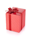 Red gift box with ribbon and bow