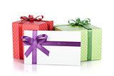 Colorful gift boxes and letter with ribbon and bow