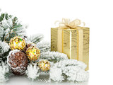 Gift box, christmas decor and snowy fir tree