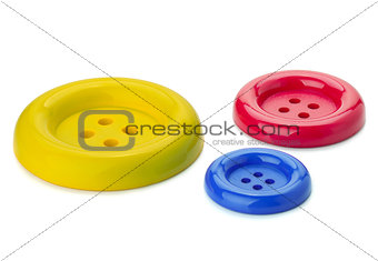 Three colored sewing buttons