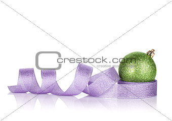 Green sparkling christmas bauble with purple ribbon